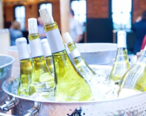 Wine bottles in a ice bucket displaying why wet strength product labels are essential